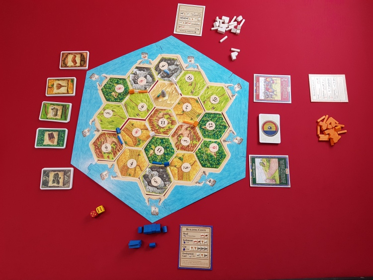 A picture of the Settlers of Catan. as the game is about to start.