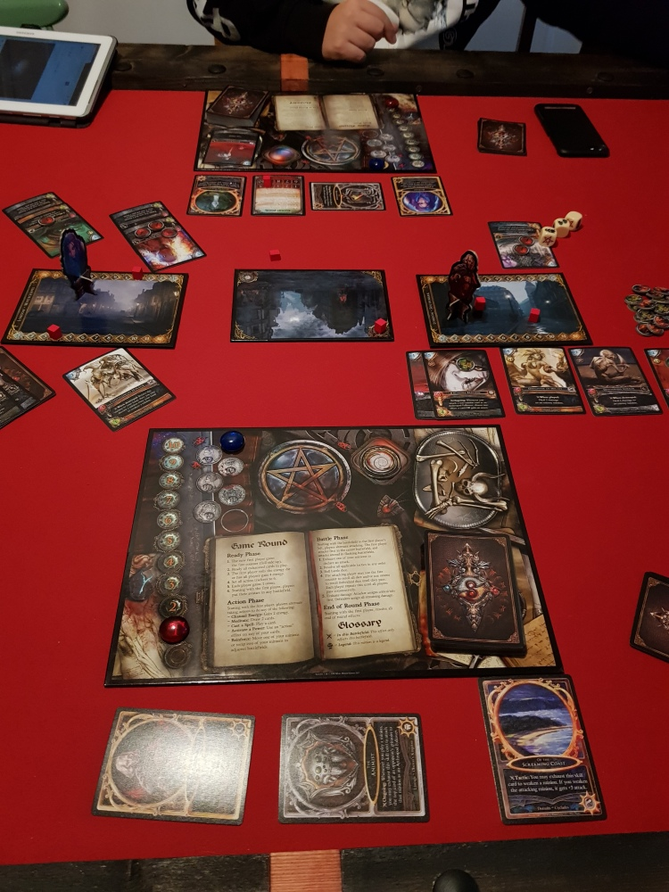 A picture of the table playing sorcerer. One battlefield has gone to me and the other ones are still being fought over.